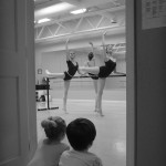 Photo of two dancers being watched by young students
